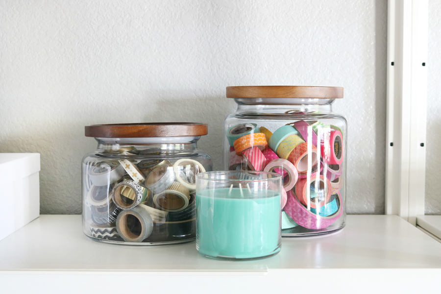 Simple & Stylish Craft Studio Organization. Use large glass jars or containers to organize small odds and ends.