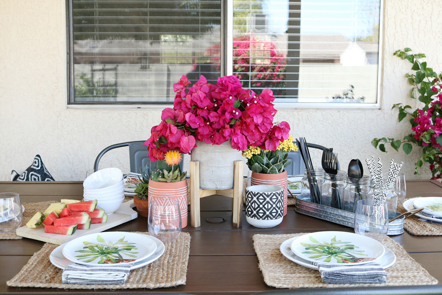 Modern farmhouse mixed with texture and color for a simple and easy outdoor entertaining set up.