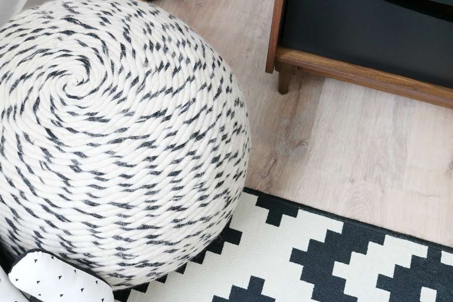 Teen Boy's Room Decor - A Better Home & Gardens Wool Swirl Pouf offers a comfy spot for gaming.