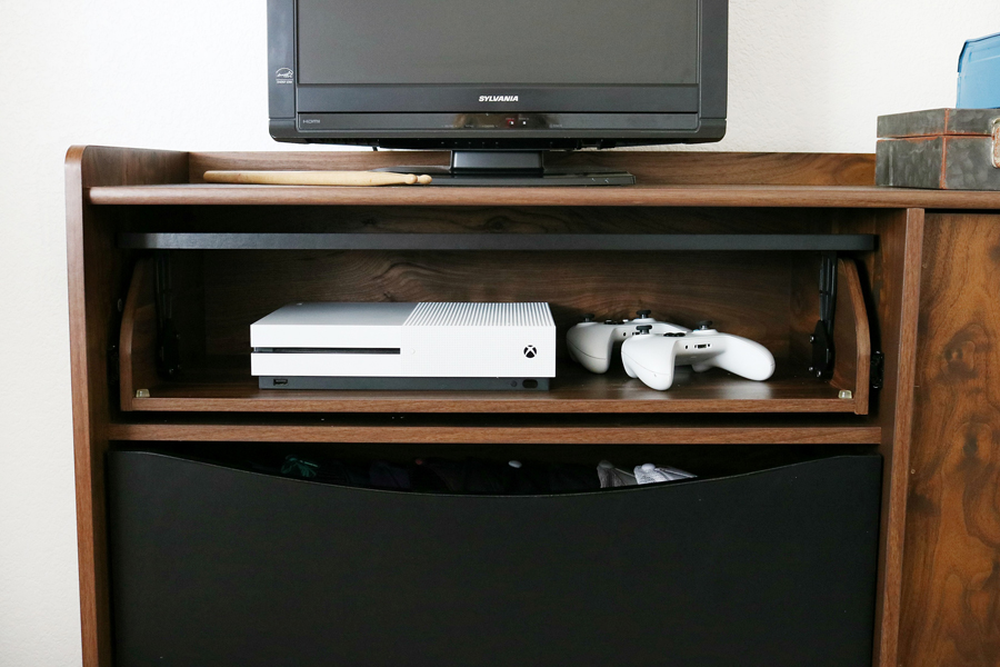 Teen Boy's Room Storage Solutions - Hide gaming consoles inside a credenza for a clean look.