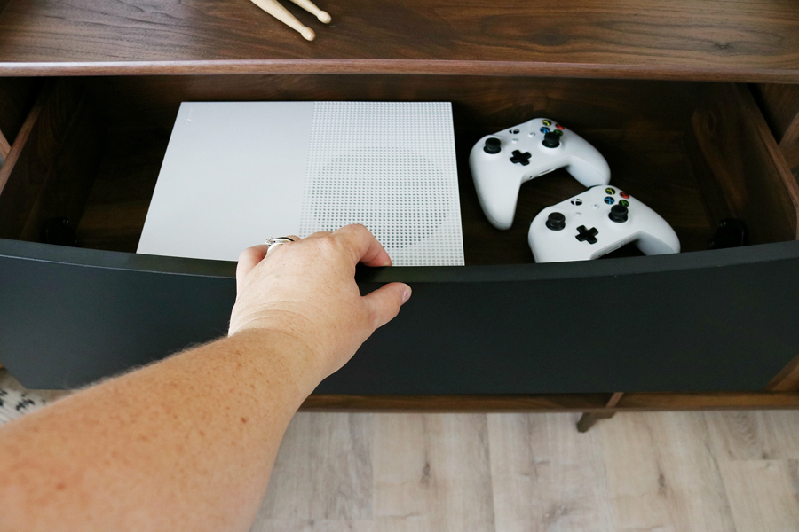 Teen Boy's Room Storage Solutions - Hide teens gaming systems in a console or credenza for easy clean up.