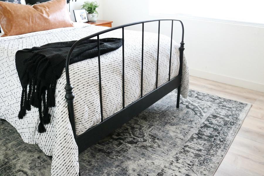 Black & White Boho Inspired Bedroom with Distressed Medallion Rug