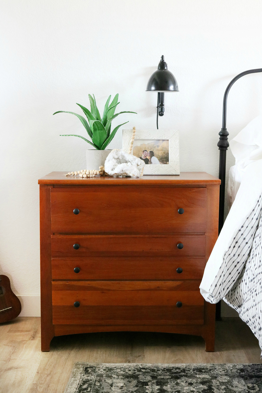 Boho Inspired Bedroom Nightstand Decor with Wall Sconce