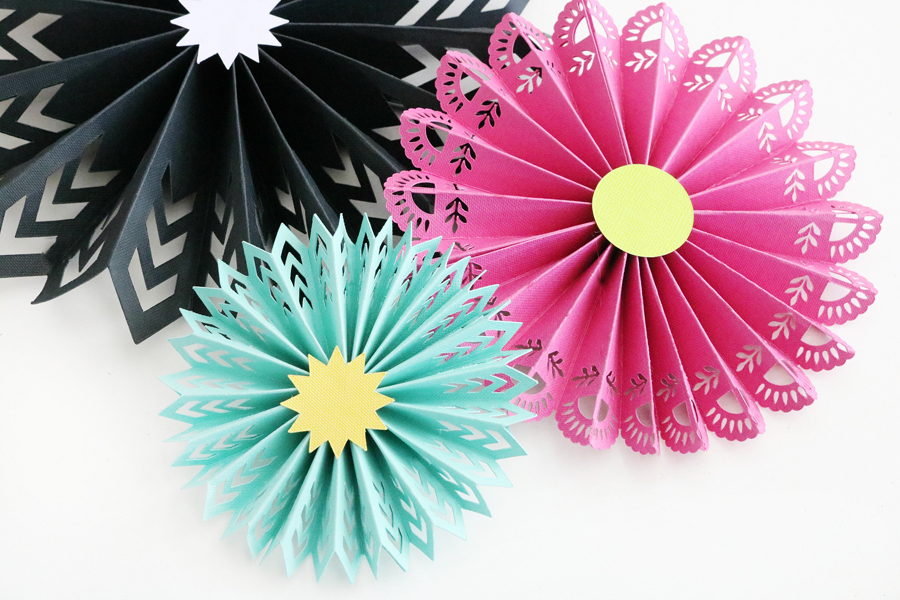 Easy DIY Fiesta Inspired Decor - Make paper rosettes so easily with the new Cricut Maker scoring wheel.