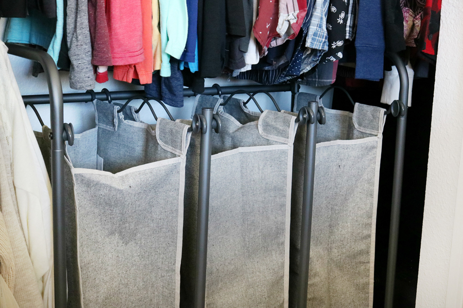 Easy Organization Idea - Place laundry sorter in closet in a small space to keep the room clean