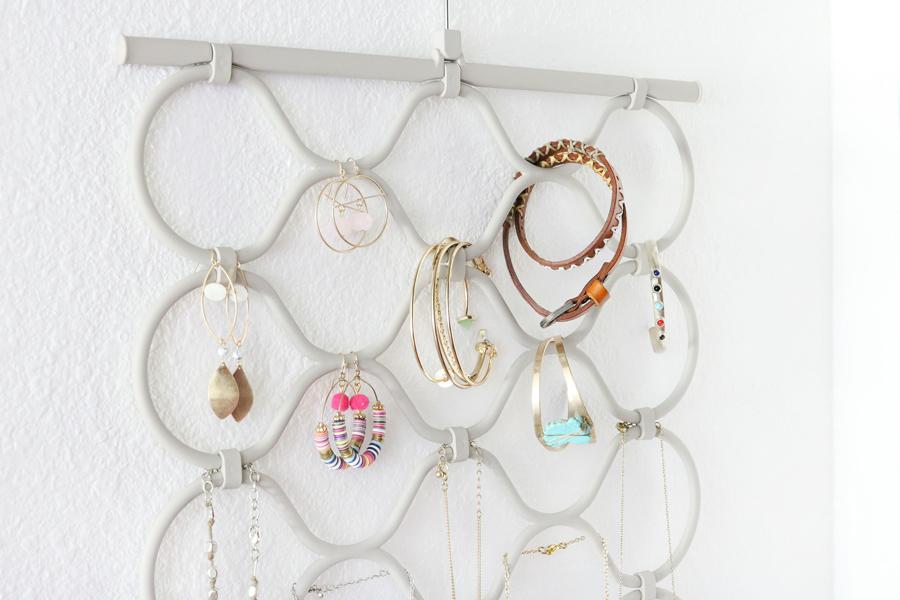 Easy Organization Idea - Use a scarf hanger as a jewelry organizer