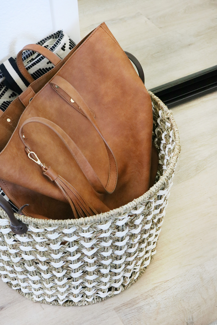 Easy Organization Idea - Use large baskets for handbags, extra bed pillows, or throw blankets