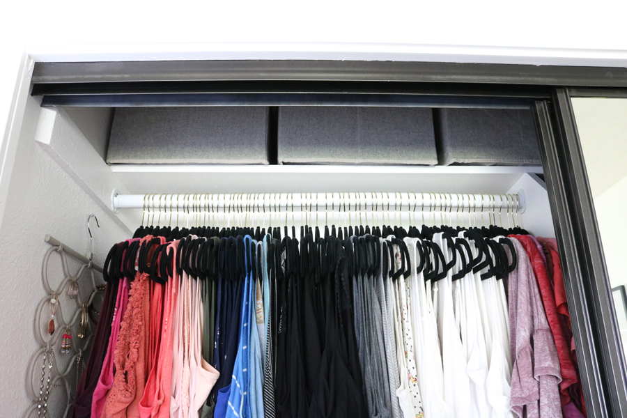 Easy Organization Idea - Utilize the top shelf for items that are less used, organize into fabric boxes for a clean look