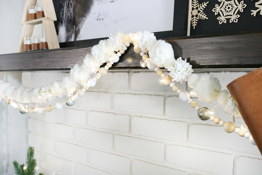 Casual Boho Christmas Decor - Mix textured pom-pom garlands with wood beads, and small twinkle lights.