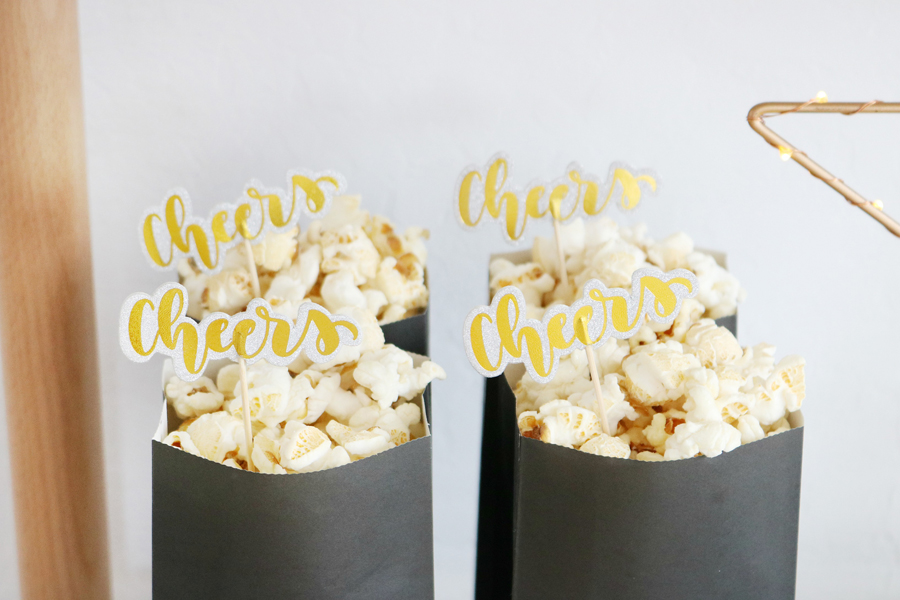 Black & White New Year's Eve Bar Cart Ideas - Simple Paper Bags Filled with Popcorn and Festive Decorations
