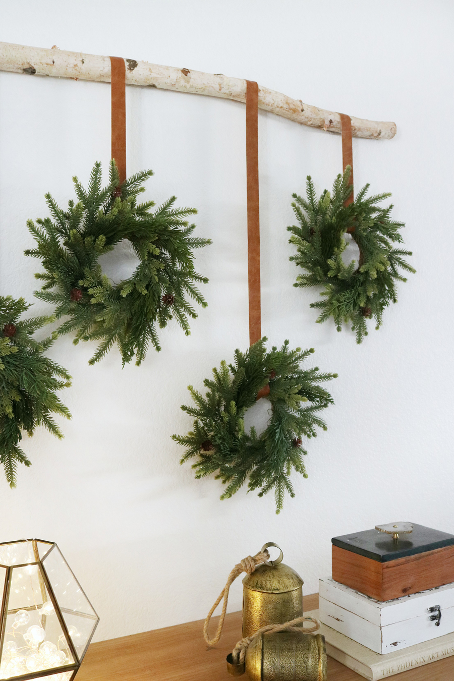 Create Simple and Easy Holiday Decor by Hanging Classic Holiday Wreaths with A Modern Twist