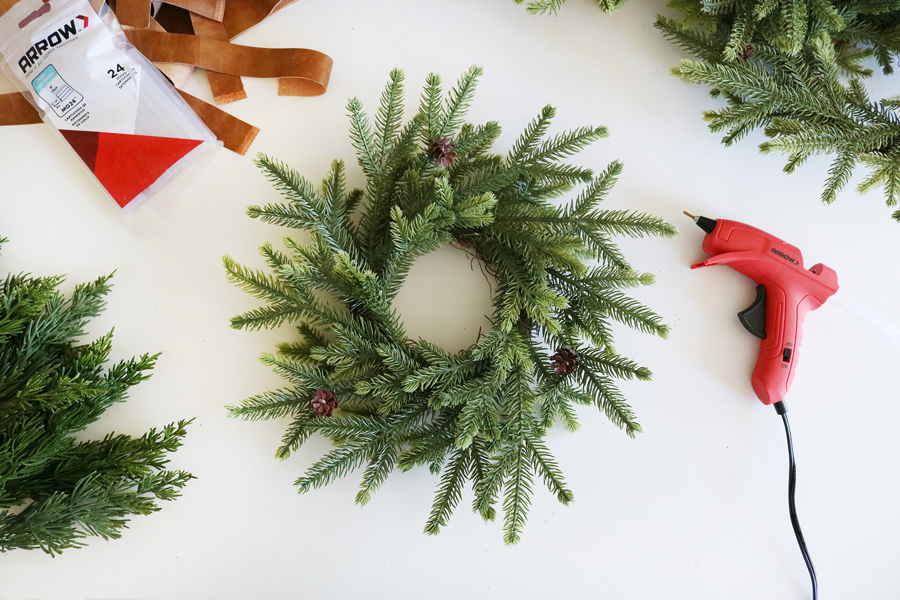 Turn Simple Holiday Wreaths Into A Modern Christmas Wall Hanging