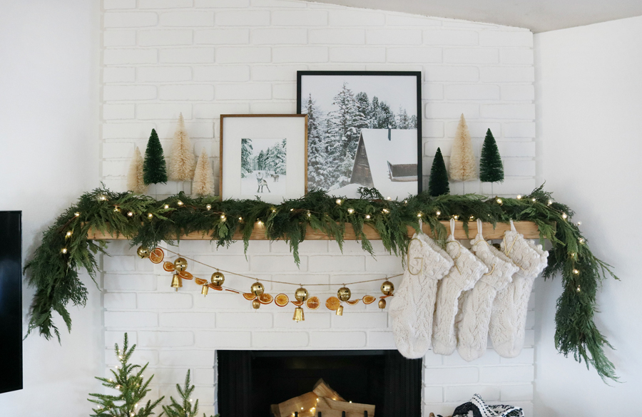 Add Live Garland to Your Neutral Decor and Modern Winter Prints for a Cozy Holiday Mantel